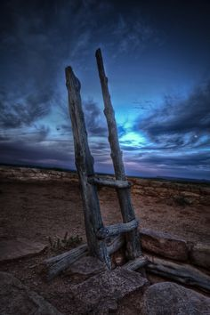 A ceremonial ladder descends into an ancient Pueblo Indian Kiva in blending, Utah.