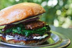 A vegetarian burger made with grilled portobello mushrooms and grilled onions, spinach, and sun-dried tomatoes.