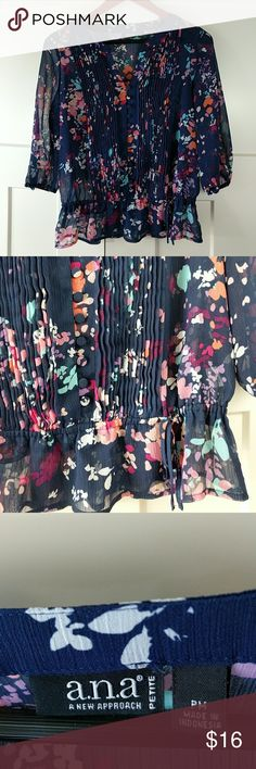 """Blue floral blouse shirt PM Excellent condition.  Sheer .  Elastic band at the waistline, and the sleeve cuffs.  24"""" top to bottom; 20"""" arm pit to arm pit; 9"""" arm pit to sleeve cuffs.  16"""" shoulder seam to end of sleeve; 3"""" neckline to shoulder seam. a.n.a Tops Blouses"""