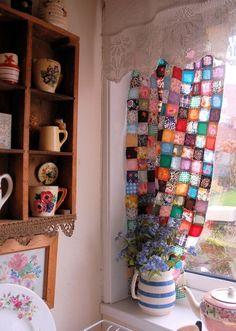 Beautiful patchwork kitchen curtains. The sun shining through makes them look like gems! karolinesworld:    http://posy.typepad.com
