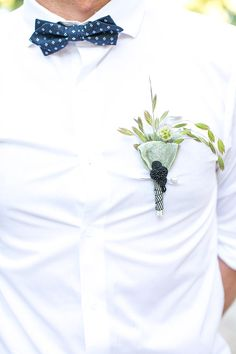 unique boutonniere, photo by Adene Photography http://ruffledblog.com/botanical-stellenbosch-wedding #groom #boutonnieres