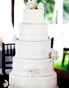 Classic white wedding cake with fresh flower accents & beaded piping