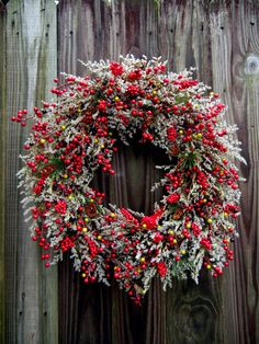 red berries and silver 'greenery' (dusty miller or artimesia) Add a cardinal to make a pretty weath