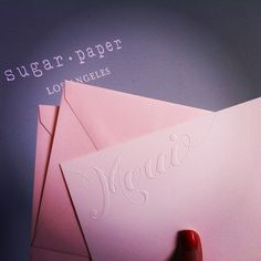 sugar paper los angeles.  blind emboss.