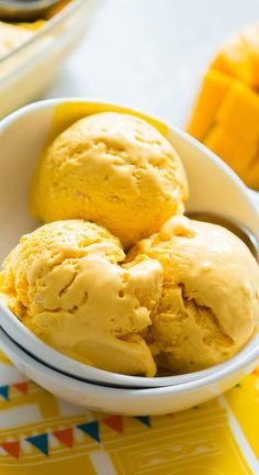 This homemade mango cheesecake ice cream is no churn and the best ice cream I've made at home so far only 5 ingredient. It's perfectly creamy, slightly tangy and so so smooth. And the cheesecake flavor is spot on!