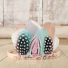 feather pixie crown (dusty peach, mint & polka dots). $30.00, via Etsy.