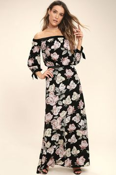 Take a sunset stroll in the Santa Margherita Black Floral Print Two-Piece Maxi Dress! A pink, cream, and green rose print dances across textured woven poly as it shapes an off-the-shoulder crop top with satin trim, tying three-quarter sleeves and an elasticized hem. Pair with the high-waisted maxi skirt with elastic at back. Hidden back zipper/clasp.