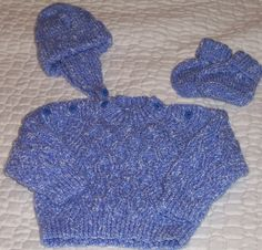 For a baby Boy, Jumper with  buttons on each side of neckline, Helmet and little Boots
