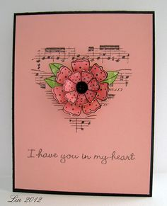 I love the musical heart behind the flower.