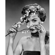Portrait of a young woman peeking through flowers Canvas Art - (18 x 24)