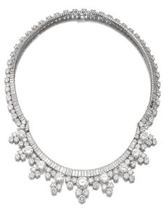 Designed as a line of baguette diamonds, suspending a fringe of brilliant-cut diamonds, inner circumference approximately 390mm, maker's mark for Wilm, a few diamonds deficient, pouch stamped H.J. Wilm. Via Sotheby's.