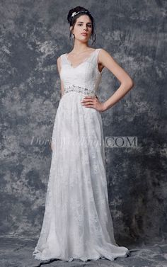 This floral lacy gown flows full length to the floor. With a pooling court…