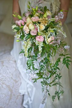 . Victorian style trailing bouquet with roses, pink lissianthus, jasmine and peirus.