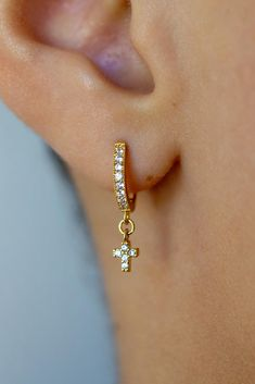 Cute Tiny Huggie Hoop Earrings with Cubic Zirconia Dangle Cross   ✏️DESCRIPTION • High quality Gold Plated earrings • Gold Plated Cross with Clear Cubic Zirconia stones • Earrings measure 12mm  • Cross measures 5x4mm  ✂️HOW TO ORDER • Click to add to cart Etsy Jewelry, Jewelry Stores, Handmade Jewelry, Slave Bracelet, Heart Bracelet, Cross Earrings, Stone Earrings, Gold Plated Earrings, Dangle Earrings