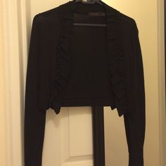 Cute bolero jacket with ruffle detail Adorable black long sleeved bolero with ruffle detail. Only worn once for a few hours! Excellent condition. Size XS The Limited Jackets & Coats
