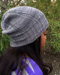 Meet Sluggy. A slightly slouchy hat, which features an easy cable pattern that will look good on the entire family!*  Notes: Instructions are written for a multiple-sized, slouchy hat. If a slouchier hat is preferred, you can either work the body of hat until desired length or go up a needle size for the body of hat. Modifications will require more yardage. Charts are provided.