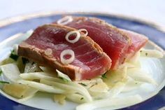 Ahi tuna, also known as yellowfin tuna, marinated in sesame oil, soy sauce, ginger, garlic, green onion, and lime juice, then pan seared.