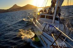 A sunset 'must do' cruise for locals and tourists alike. Toast the setting sun from the deck of a luxury vessel with a complimentary glass of local sparkling wine. Capes For Kids, Red Bus, Table Mountain, Day Tours, Wine Country, Cape Town, Sailing Ships, Boat