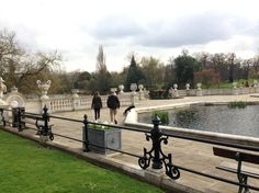 Kate walking Lupo on 4/19/13 in the Italian Gardens at Kensingon. The man in attendance with Kate is one of the royal protection guards.