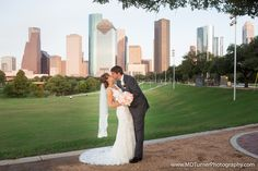 Lovely v-neck lace dress with long train and lace trimmed veil - Houston wedding photography - MD Turner Photography