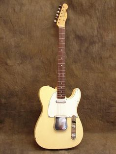 Gorgeous honey blonde 1966 Fender Telecaster with ash-tray cover