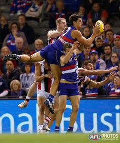 AFL Photos, buy official AFL prints from the official AFL photographers. The Slattery Media Group brings you the most current player and match photos from all games of all rounds of the AFL season. Australian Football League, Western Bulldogs, Great Team, Rugby, Legends, Champion, Soccer, Action, Lovers
