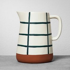 Add a touch of simple rustic charm to your table setting for everyday meals or special occasions with this Stoneware Pitcher from Hearth & Hand™ with Magnolia. This sturdy and durable stoneware pitcher features a simple grid pattern with a terracotta-colored bottom for a touch of natural style. You can use this patterned stoneware beverage pitcher to hold water or juice on your table, or you can use it as a decorative vase on an end table or entryway table. <br><br>Ce...