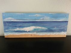 Hand painted acrylic artwork on 100 percent recycled pallet wood. Measures 39 x 15. Beautiful oceanscape painting will come with hanging wire attached