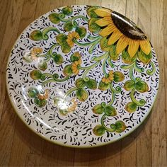 These sunny yellow Tuscan sunflowers bloomed just-in-time to grace your Italian tabletop.