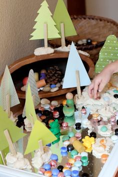 An open-ended invitation to play with loose parts designed to encourage toddlers to create a forest, explore sensory elements, engage in imaginative play, and practice beginning storytelling. Reggio-inspired