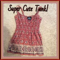 Super Cute Tank This is a size M flows tank with just the right amount of bling sequins!  Looks awesome with jeans and a cardigan!  The cardigan paired in the photo is also in my closet! Tops Tank Tops