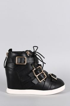 Description This high top wedge sneaker features a round toe, vegan leather upper with multiple buckle straps accent, and metallic zipper trim. Finished with hidden wedge heel, cushioned insole, padde