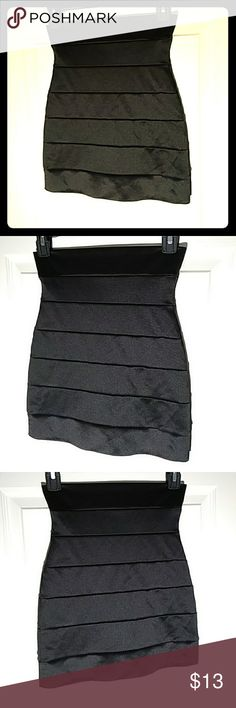 Black Mini Skirt Silk feel. Mini skirts are outside of my realm. In good condition, no sign of wear! Love Culture Skirts Mini