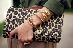cheetah print clutch with gold accessories