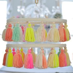 """""""Handmade colorful yarn tassel chandelier, for decorating baby nurseries, baby showers, playrooms, and bedrooms. THE SORBET CHANDELIER is a handmade tassel decoration, made with acrylic/wool yarns. This colorful tassel chandelier is perfect for baby showers, nurseries, party decor, photo backdrops, birthday parties, retail shop displays, boho weddings, and just about anywhere you can imagine! It is lovely to use this as a shower decoration, then give it to the mom-to-be as a keepsake and nursery Boho Nursery, Nursery Decor, Newborn Nursery, Girl Nursery, Room Decor, Tassel Garland, Tassels, Nursery Chandelier, Atelier D Art"""