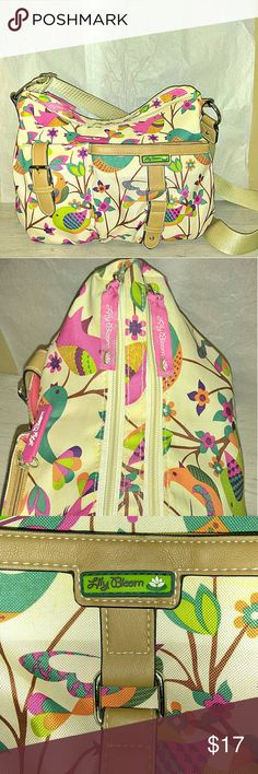 """Lily Bloom Kathryn Canvas Crossbody Purse I love this canvas print. Two outside pockets with buckles. Two slots with zippers. Crossbody in great pre-owned condition. Flowers and birds canvas print.  14x10 1/2"""" 24"""" strap length Lily Bloom Bags"""