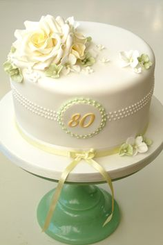 "Small cake for top of cupcake tower - simple cake with ""80"" and flowers that match those in the mason jars"