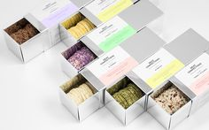 Anagrama has created a branding and package design for Neat Confections. With perfection being the main objective in Neat Confections branding,  Anagrama took that concept and created a packaging that reflected the  pureness of what the pastry shop offers, a cake and cookie that is baked  and prepared to perfection. The silver chrome packaging paired with neon  pastel touches truly stands out and creates a unique design that evokes a  feeling of purity when purchasing these delicious ...