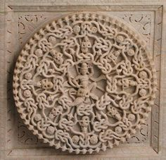 Ornate Ornamental Naga carving on ceiling at Ranakpur Jain Temple, Rajasthan Symmetry is amazing!