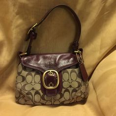 """Coach Bleecker Coach Bleeker signature Hobo Flap Bag #11441 Khaki signature """"C"""" fabric with burgundy leather.  Goldtone buckle.  Magnetic closure.  Lining gold.  No stains, rips, or tears.  Like new carried only a few times.  Measurements 10"""" x 7"""" x 2"""" with 8"""" strap drop. Coach Bags"""