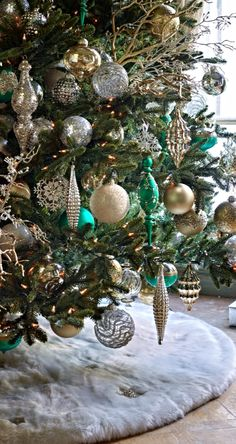 Gold, silver and a heavenly teal are the primary colors in our elegant Donatella Ornament Collection. Oh the splendor!