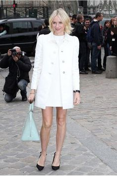 After a season of success on the red carpet, Naomi Watts proves she's not slowing down any time soon. She attended the Louis Vuitton AW13 Fashion Show in a crisp white shift dress and coat from the French Fashion House. What's really had us swooning though is that mint green tote of hers!