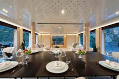 The dining area leads into an open plan living space where there are plush white furnishings and an oriental theme throughout
