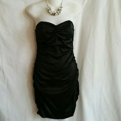 I just added this to my closet on Poshmark: Express Size 2 Strapless Dress Black. Price: $15 Size: 2