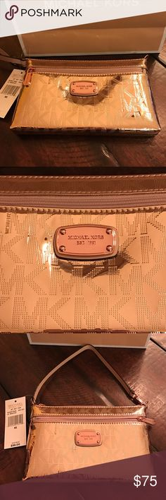 Michael Michael Kors Jet Set Wristlet♦️ Michael Michael Kors Jet Set Wristlet♦️. NEW!  Fits IPhone 7 Plus. Beautiful rose gold color. Outside zippered pocket. Inside has 4 card slots and 1 larger open pocket. Wristlet  strap can be unclipped and attached to larger Bag or attached to other side of this bag for a mini purse look MICHAEL Michael Kors Bags Clutches & Wristlets