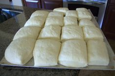 Texas Roadhouse rolls*4 teaspoons active dry yeast  1/2 cup warm water  2 cups milk scalded and cooled to lukewarm  1/2 cup plus 1 teaspoon sugar, separated  3 tablespoons melted butter, cooled slightly, plus additional for brushing   7-8 cups flour (I used about 7 1/2 cups)  2 whole eggs  2 teaspoons salt