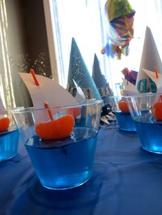 jello cups with boats add a gummy shark for full effect
