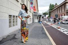 Milan Fashion Week's many sparkly, selfie-worthy moments weren't just inside the shows. Outside, the street style was on point even when the weather got dreary, and when it brightened up, showgoers like Giovanna Battaglia brought out the topknots and short, bright frocks.