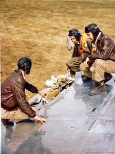 """The crew of the Boeing B-17 """"Peacemaker"""" examines battle damage to the wing of the plane, England. -"""