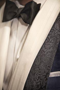 black tuxedo wedding groom with white scarf and black bow